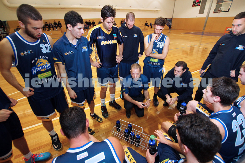 1-6-14. Basketball. Maccabi Warriors lost to Mornington Breakers. 43-61.  Coach Drew Solewicz addresses the players at a time out.  Photo: Peter Haskin
