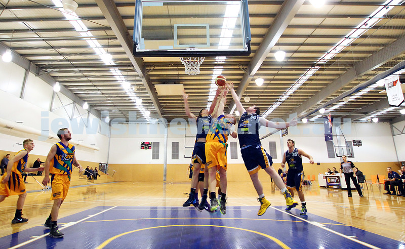 1-6-14. Basketball. Maccabi Warriors lost to Mornington Breakers. 43-61. Beni Tamir (5) and Nick Alexandrou jump for the rebound. Photo: Peter Haskin