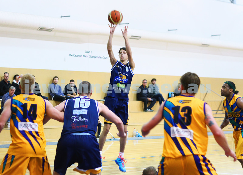 1-6-14. Basketball. Maccabi Warriors lost to Mornington Breakers. 43-61. Ben Polonsky taking a jump shot. Photo: Peter Haskin