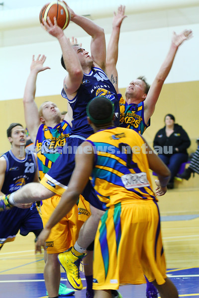1-6-14. Basketball. Maccabi Warriors lost to Mornington Breakers. 43-61. Nick Alexandrou takes a rebound in heavy traffic. Photo: Peter Haskin