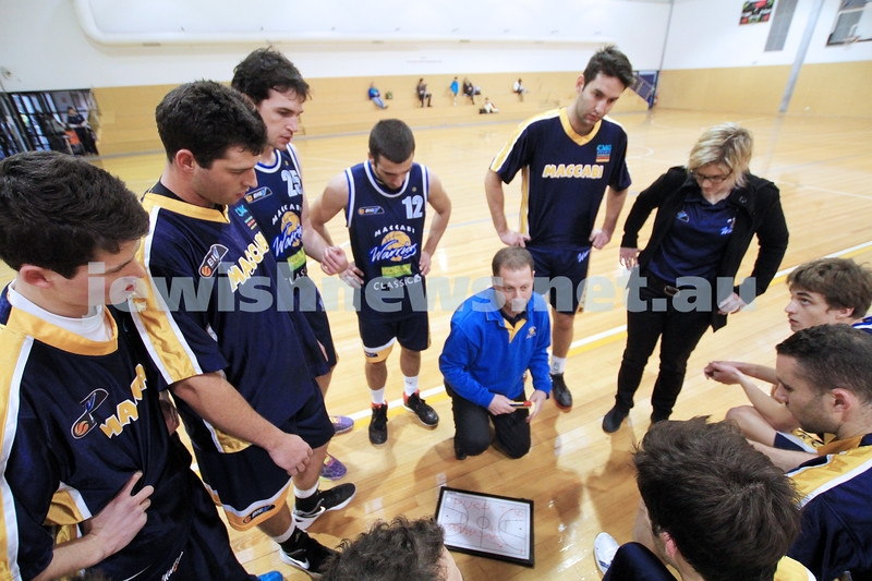 1-7-12. Maccabi Warriors basketball v Mornington. Photo: Peter Haskin. Coach Andrew Solewicz addresses his players.