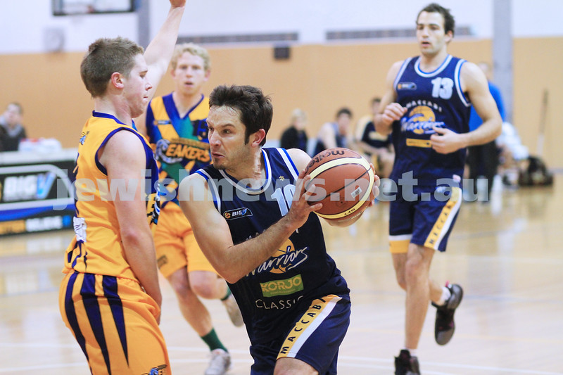 1-7-12. Warriors basketball v Mornington. Jeff Devers taking it to the hoop. Photo: Peter Haskin
