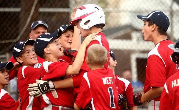6-21-12<br /> Championship little league game between Lion's Club and McPike<br /> The McPike team congratulates Nate Hemmerich on home plate after he hit a homerun during the championship game against Lion's Club on Thursday.<br /> <br /> KT photo | Kelly Lafferty