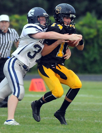 Mankato East quarterback Nic Seiler can't outrun Rochester Century's Tanner Roy during the first half Friday at Wolverton Field. Photo by Pat Christman