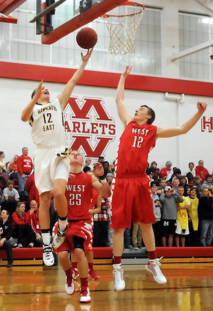 Pat Christman<br /> Mankato East's Brock Margenthaler shoots as Mankato West's Jonah Boone defends him during the first half Saturday.