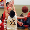 Pat Christman<br /> Mankato West's Jake Dale tries to keep control of the ball as he is guarded by Mankato East's Nic Seiler during the first half Saturday.