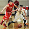 Pat Christman<br /> Mankato West's Alex Goettl, left, and Mankato East's Nic Seiler scramble for a loose ball during the first half Saturday at the West gym.