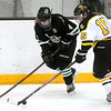 Pat Christman<br /> Litchfield-Dassel-Cokato's Kennedy Sommerfeld and Mankato East/Loyola's Kylie Paulson battle for the puck during the first period of their Section 2A championship game Thursday at Gustavus Adolphus College in St. Peter.