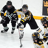 Pat Christman<br /> Mankato East/Loyola's Bella Davis weaves through players during the first period of their Section 2A championship game Thursday at Gustavus Adolphus College in St. Peter.