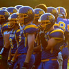 Members of the Mankato Loyola football team watch the game Friday. Photo by Pat Christman