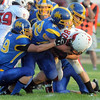 Mankato Loyola defenders stop Bethlehem Academy's Bryan Brazil during the first half Friday. Photo by Pat Christman