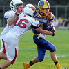 Mankato Loyola's Noah Rajtar tries to shed a pair of defenders during the first half Friday. Photo by Pat Christman