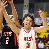 Pat Christman<br /> Mankato West's Tyler Stoffel (3) and Marshall's C.D. Douglas battle for a rebound during the first half of their Section 2AAA championship game Thursday at Bresnan Arena.