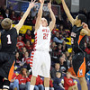 Pat Christman<br /> Mankato West's Steven Nessler shoots between a pair of Marshall defenders during the second half of their Section 2AAA championship game Thursday at Bresnan Arena.