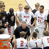 Pat Christman<br /> Mankato West head coach Tom Boone discusses strategy with his players during a timeout Thursday.