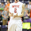 Pat Christman<br /> Mankato West's Jake Makela celebrates a basket near the end of regulation time during their Section 2AAA championship game against Marshall Thursday at Bresnan Arena.