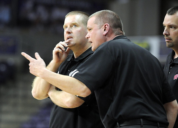 Pat Christman<br /> Mankato West coaches discuss strategy during the closing moments of overtime during the Section 2AAA championship game Thursday at Bresnan Arena.