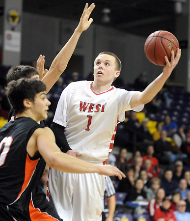 Pat Christman<br /> Mankato West's Jake Dale shoots around a Marshall defender during the second half of their Section 2AAA championship game Thursday at Bresnan Arena.