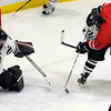 Pat Christman<br /> New Prague goalie Conner Wagner makes a save on a shot by Mankato West's Zachary Erickson during the first period of their Section 1A championship game Thursday at the Rochester Recreation Center.