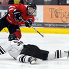 Pat Christman<br /> Mankato West's Zachary Erickson shoots over a diving Dan Beckius of New Prague during the second period of their Section 1A championship game Thursday at the Rochester Recreation Center.