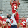 Mankato West's Josh Athey leaps to intercept a pass intended for Albert Lea's Sam Moyer Thursday. Photo by Pat Christman