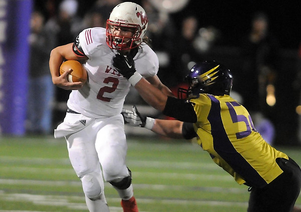 Pat Christman<br /> Mankato West quarterback Ryan Schlichte can't escape the grasp of Chaska's Lucas Ward during their Section 2AAAAA championship game Friday in Chaska.