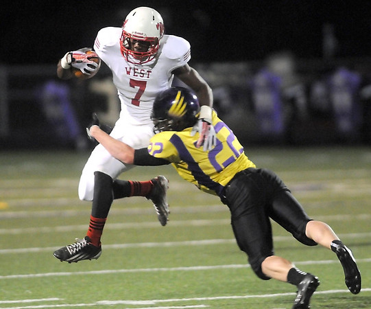 Pat Christman<br /> Mankato West's Travon Jones leaps as he's hit by Chaska's Zach Mader during their Section 2AAAAA championship game Friday in Chaska.