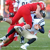 Pat Christman<br /> Mankato West's Alex Goettl sacks Chanhassen quarterback Joe Rosburg during the second half Saturday at Todnem Field.