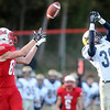 Pat Christman<br /> Chanhassen's Drew Poppen tips a pass intended for Mankato West receiver Will Claussen during their game Saturday.