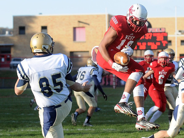 Pat Christman<br /> Mankato West's Braedan Myers blocks a punt by Chanhassen's Sam Oddo and catches it for a touchdown during the second half of their Section 2AAAAA semifinal game Saturday at Todnem Field.