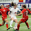 Mankato West's Madison Burandt (19) and Hannah Fox defend against Benilde-St. Margaret's Kelly Pannek in Class A semifinal action at the Metrodome on Monday.