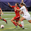 John Cross<br /> Mankato West's Sarah Buryska and Benilde-St. Margaret's Megan Katopodis race each other toward the ball in State Class A action at the Metrodome on Monday.