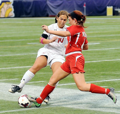 John Cross<br /> Mankato West's Sydney Malone attempts to steal the ball from Benilde-St. Margaret's Katie Katopodis during state Class A action at the Metrodome on Monday.