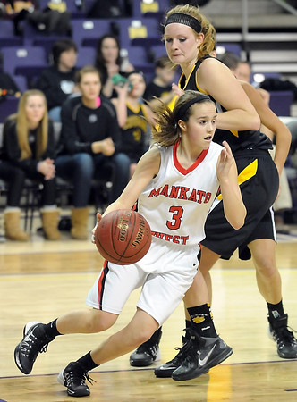 Pat Christman<br /> Mankato West's Emily Veroeven slips around Mankato East's Claire Ziegler during the second half Tuesday at Bresnan Arena.