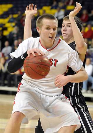 Pat Christman<br /> Mankato East's Nic Seiler defends Mankato West's Jake Dale during the first half Tuesday at Bresnan Arena.