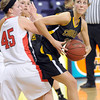 Pat Christman<br /> Mankato East's Taylor Karge tries to get around Mankato West's Hannah Hastings during the second half Tuesday at Bresnan Arena.