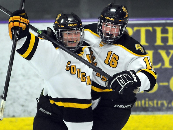 Pat Christman<br /> Mankato East/Loyola's Kylie Paulson, left, celebrates one of her first period goals with teammate Tatum Schulz Tuesday at All Seasons Arena. Paulson had four goals in East/Loyola's win over crosstown rival Mankato West.