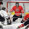 Pat Christman<br /> Mankato West goalie Conor Wollenzien keeps an eye on play during the first period.