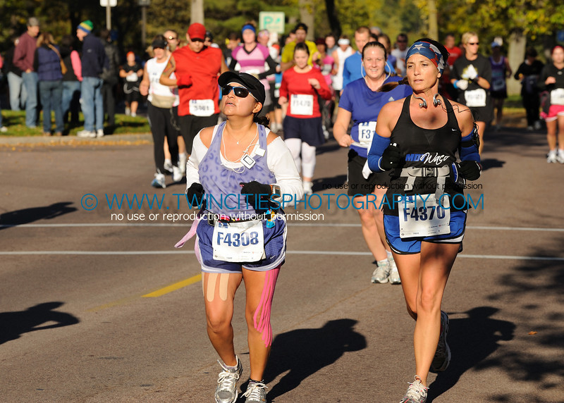 """<font size=""""4"""" face=""""Tahoma"""" font color=""""white"""">#F4308 PATTI CASTILLEJA<BR>#F4370 MARCENA COLLIER</font><BR>  <font size=""""4"""" face=""""Tahoma"""" font color=""""turquoise"""">2010 Twin Cities Marathon</font> <font size=""""1"""" face=""""Tahoma"""" font color=""""turquoise"""">Click on photo above to view larger size</font>"""