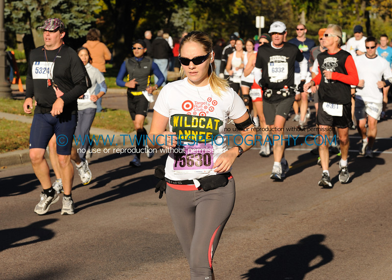 """<font size=""""4"""" face=""""Tahoma"""" font color=""""white"""">#XX </font>  <font size=""""4"""" face=""""Tahoma"""" font color=""""turquoise"""">2010 Twin Cities Marathon</font> <font size=""""1"""" face=""""Tahoma"""" font color=""""turquoise"""">Click on photo above to view larger size</font>"""