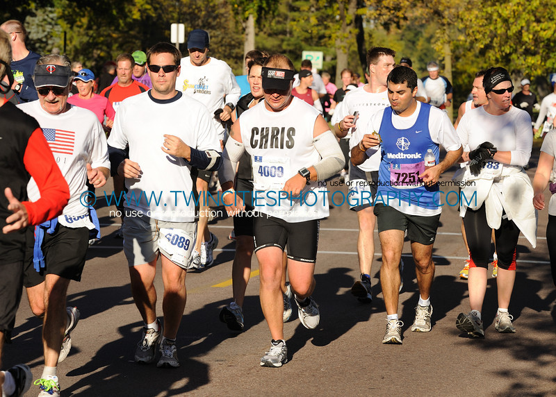 "<font size=""4"" face=""Tahoma"" font color=""white"">#XX </font>  <font size=""4"" face=""Tahoma"" font color=""turquoise"">2010 Twin Cities Marathon</font> <font size=""1"" face=""Tahoma"" font color=""turquoise"">Click on photo above to view larger size</font>"