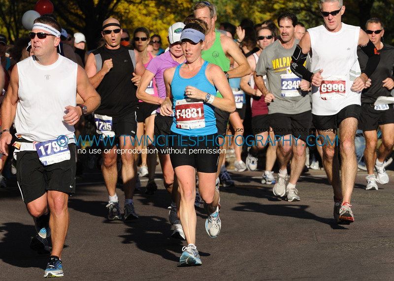 """<font size=""""4"""" face=""""Verdana"""" font color=""""white"""">#F4831 SARA WOESTE</font><br><p> <font size=""""2"""" face=""""Verdana"""" font color=""""turquoise"""">2011 Twin Cities Marathon</font><br><font size=""""2"""" face=""""Verdana"""" font color=""""white"""">Order a photo print of any photo by clicking the 'Buy' link above.</font>  <font size = """"2"""" font color = """"gray""""><br> TIP: Click the photo above to display a larger size</font>"""