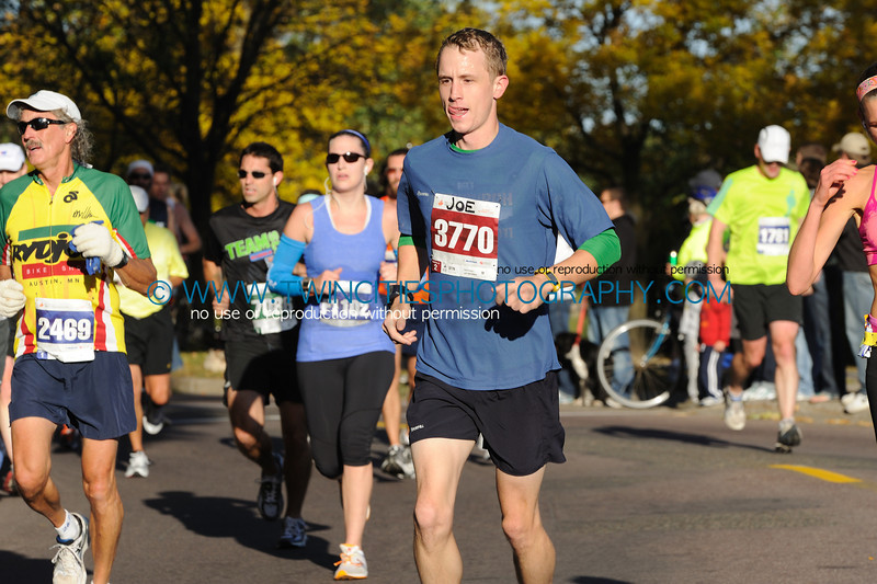 """<font size=""""4"""" face=""""Verdana"""" font color=""""white"""">#3770 JOE KRASEAN</font><br><p> <font size=""""2"""" face=""""Verdana"""" font color=""""turquoise"""">2011 Twin Cities Marathon</font><br><font size=""""2"""" face=""""Verdana"""" font color=""""white"""">Order a photo print of any photo by clicking the 'Buy' link above.</font>  <font size = """"2"""" font color = """"gray""""><br> TIP: Click the photo above to display a larger size</font>"""