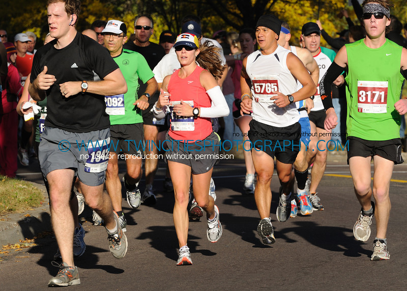 """<font size=""""4"""" face=""""Verdana"""" font color=""""white"""">#5765 DIEP DOAN<BR>#3171 WILDER WELKE</font><br><p> <font size=""""2"""" face=""""Verdana"""" font color=""""turquoise"""">2011 Twin Cities Marathon</font><br><font size=""""2"""" face=""""Verdana"""" font color=""""white"""">Order a photo print of any photo by clicking the 'Buy' link above.</font>  <font size = """"2"""" font color = """"gray""""><br> TIP: Click the photo above to display a larger size</font>"""