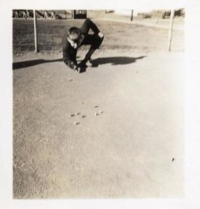Young Boy Shooting Marbles IX (01193)