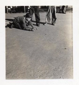 Young Boy Shooting Marbles X (01194)