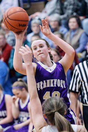 Record-Eagle/Pete Rodman<br /> Frankfort's Cecelia Schmitt shoots over Bellaire's Brandy O'Neal during the Class D girls basketball regional final at Buckley High School on Thursday.
