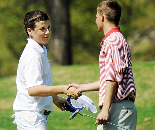 Globe/T. Rob Brown<br /> Joplin's Nick Yuhas, left, shakes hands with Webb City's Ben Starkey after finishing the 18th hole Thursday afternoon, March 29, 2012, at Twin Hills Country Club.