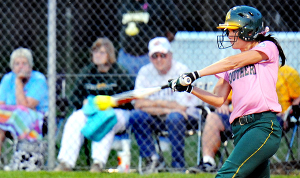 Globe/T. Rob Brown<br /> MSSU's Brooke Swadley, wearing pink for breast cancer awareness, pounds out a hit against PSU Wednesday evening, March 28, 2012, at MSSU's softball fields.