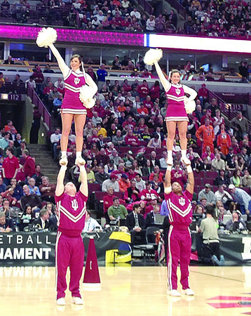 The IU cheerleaders try to get the crowd pumped up during a second half timeout Friday in the quarterfinals of the Big Ten Tournament.